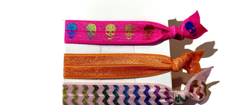 hot pink skull / orange / pink zigzag hair / wrist bands