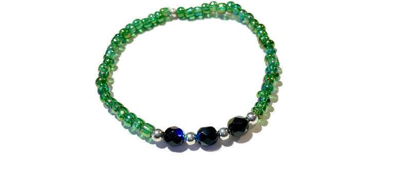 green, blue/black and silver bracelet