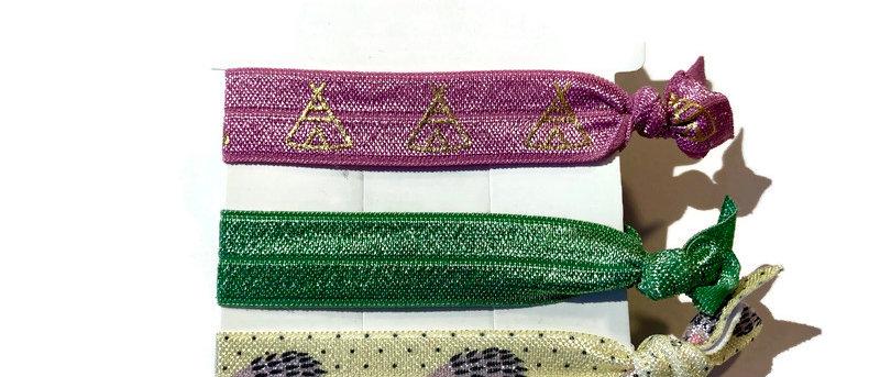 pink teepee / green / yellow hedgehog hair / wrist bands