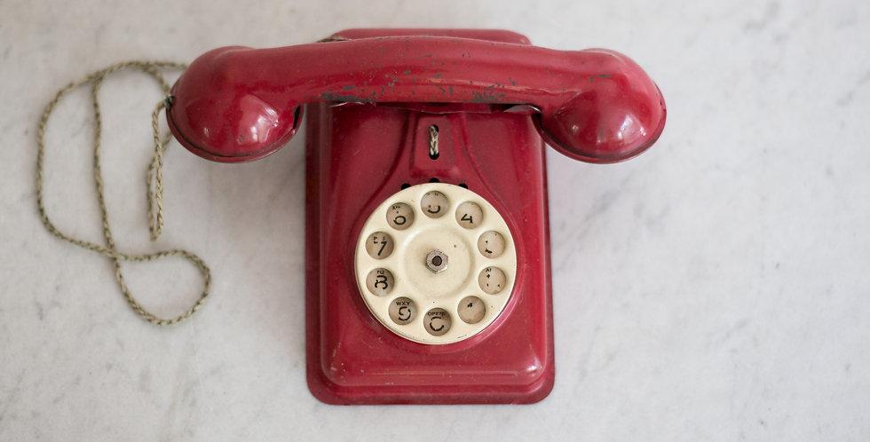 vintage children's red tin telephone