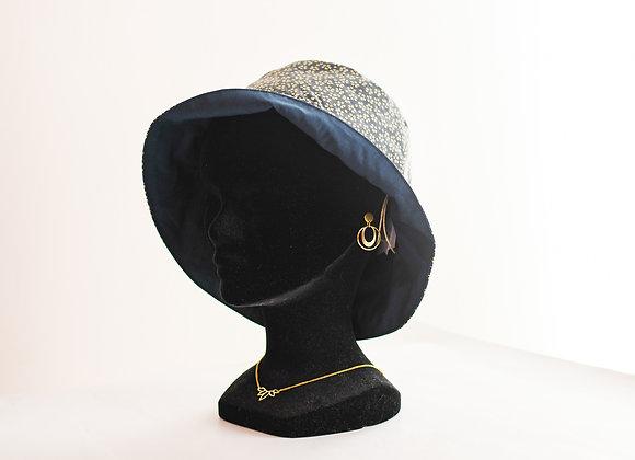 Chapeau de pluie à fleurs bleu en coton enduit