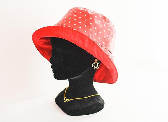 Chapeau de pluie rouge à pois blancs en coton enduit