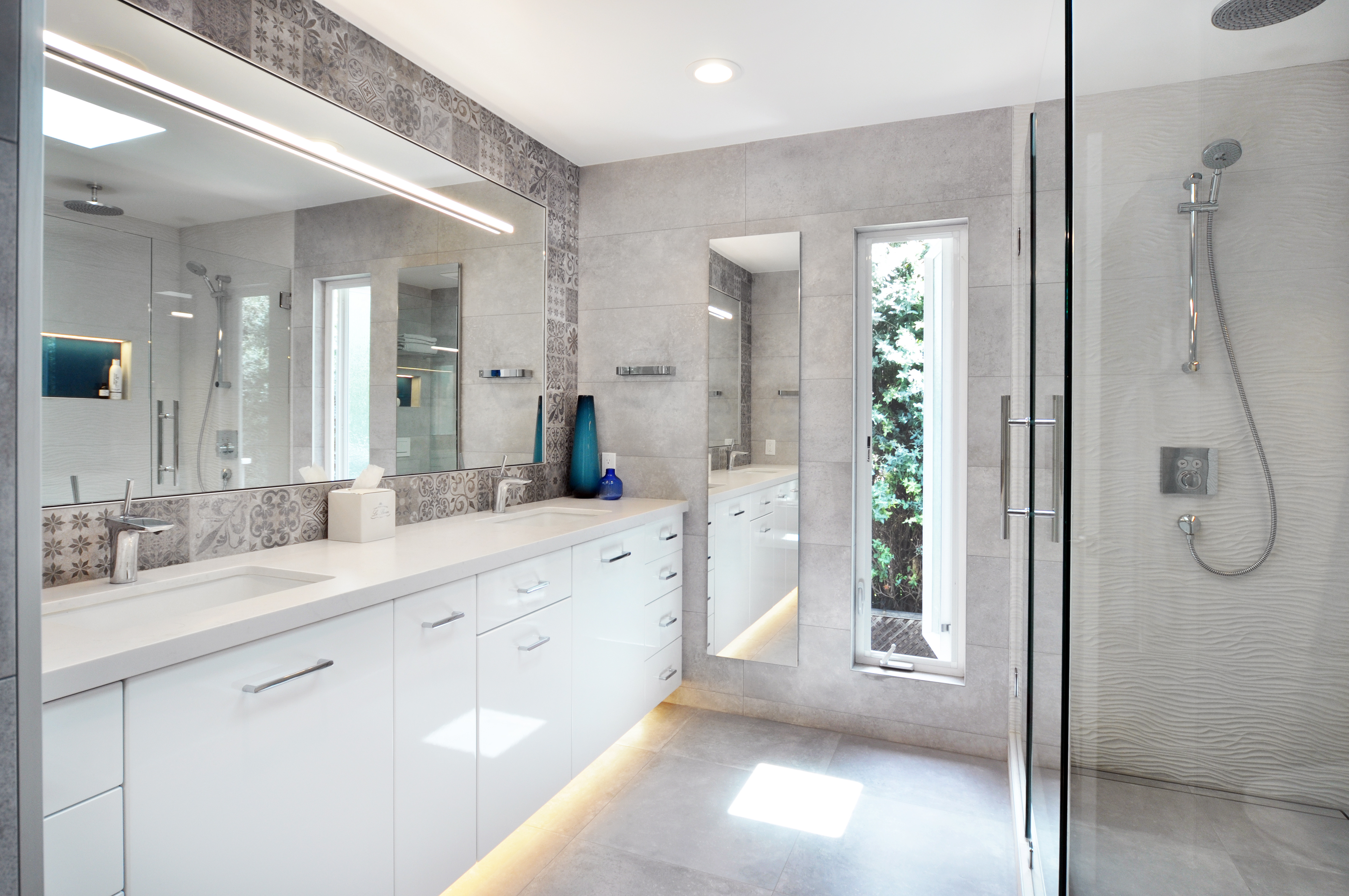 Glossy white cabinets, gray tile