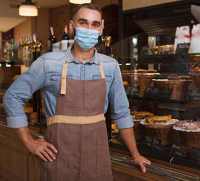 Masked business owner