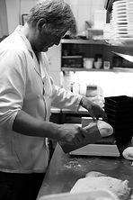 Owner Anthony making bread