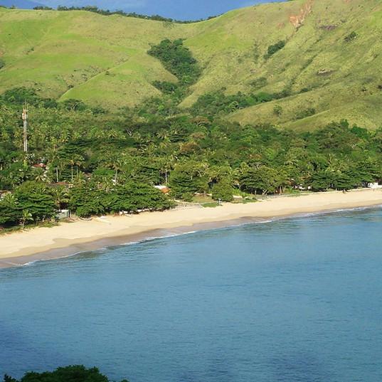 Vista da praia de Toque Toque com a propriedade ao fundo