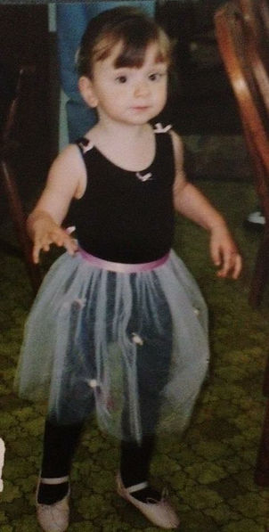 Frankie Ann as a little girl- she is wearing a black leotard and pink dance skit with pink shoes.