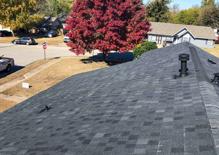 New roof on a nice house put on by David Brunson