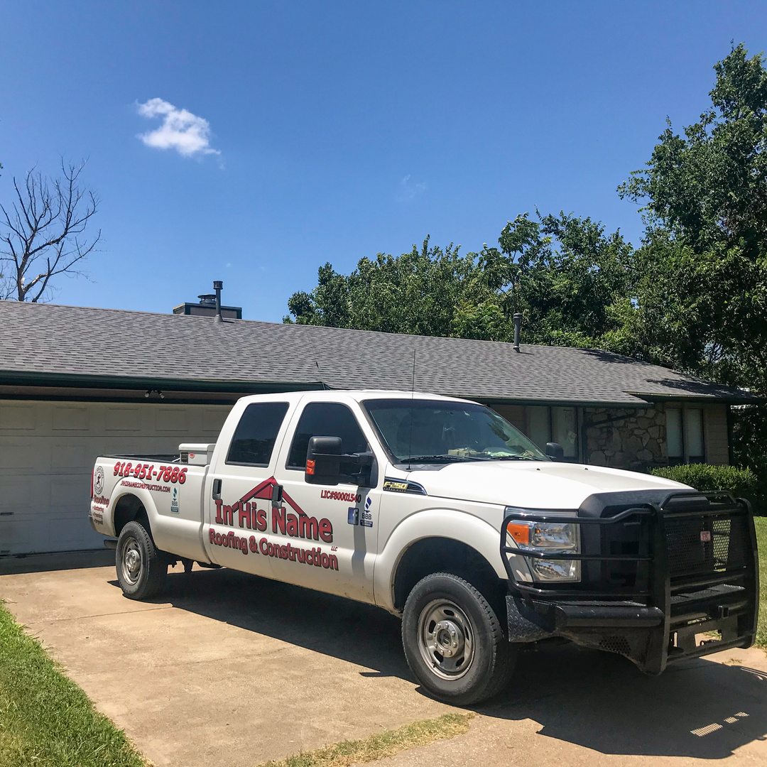 In His Name truck in front of a recently completed roof job