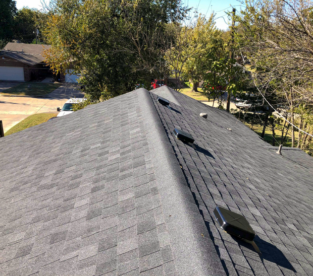Recently redone roof by In His Name Roofing and Construction