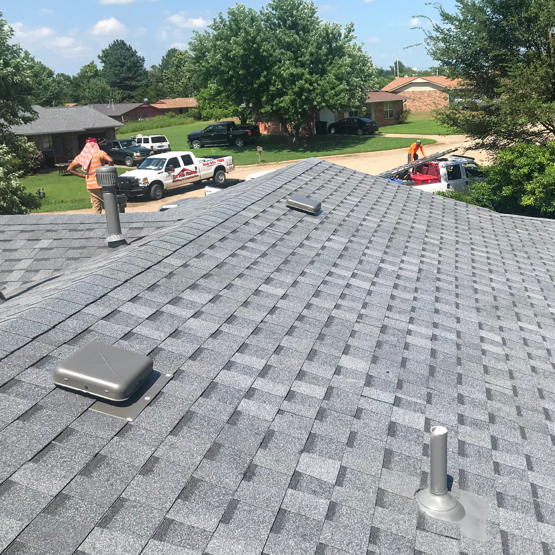 In His Name contractors working on a roof