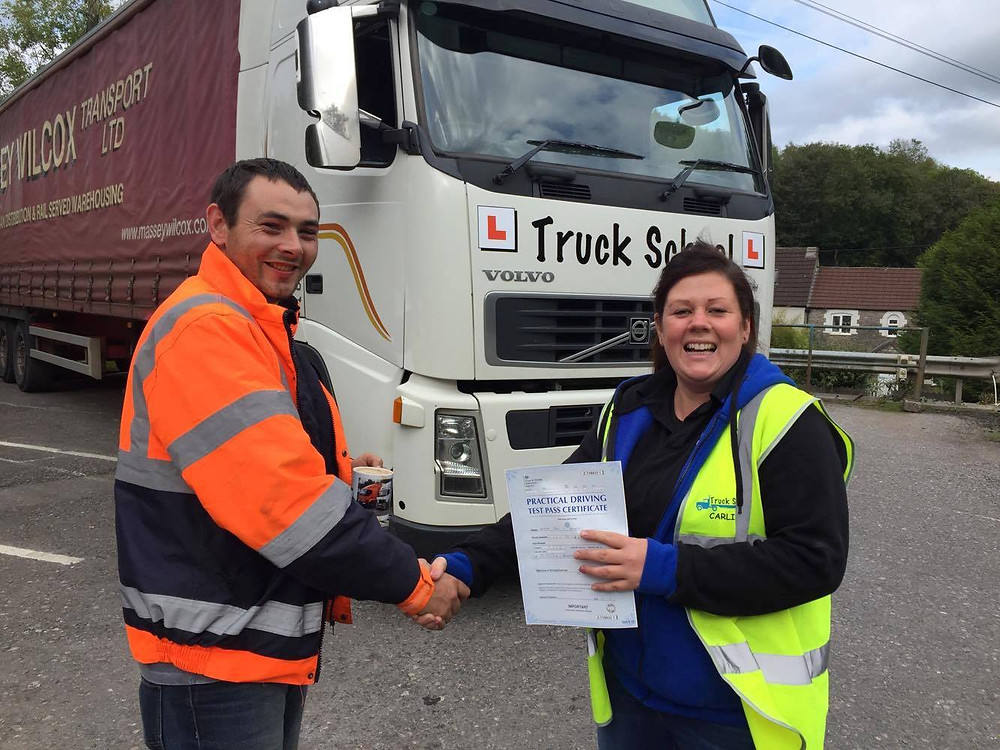 Ashley Hawkins and his female HGV instructor after Ahley's FIRST TIME class 1 test pass with Truck School