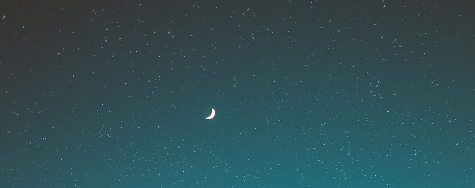 the moon and stars on a clear night sky