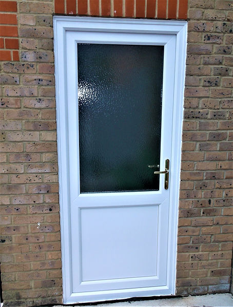 White uPVC back door with obscure glass and flat panel
