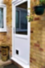 uPVC White Back Door with clear glass top panel flat bottom panel and a cat flap