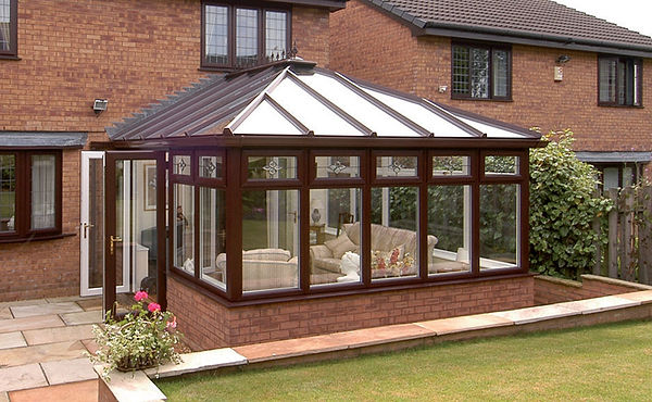 Edwardian Conservatory in brown with Ultraframe Livinroof solid roof in brown colour