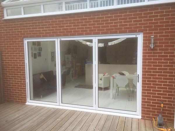 Aluminium Bi-Folding Doors in  White Colour