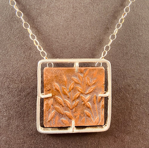 Necklace of Raised Copper Design Set in Sterling Silver
