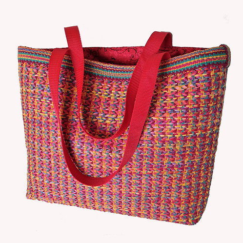 Large handwoven tote bag in shades of red, blue, and yellow