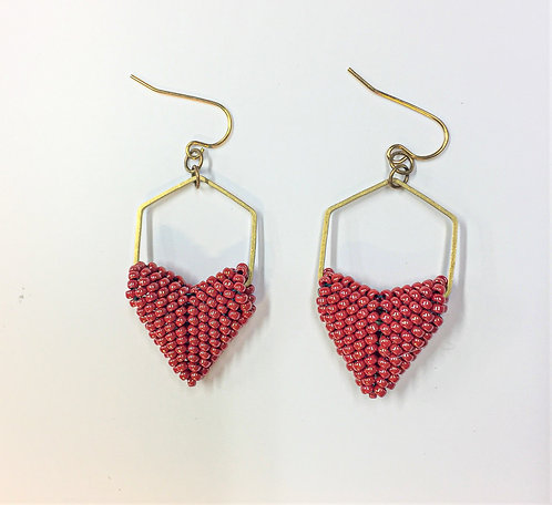 Red beaded hearts in a brass honeycomb