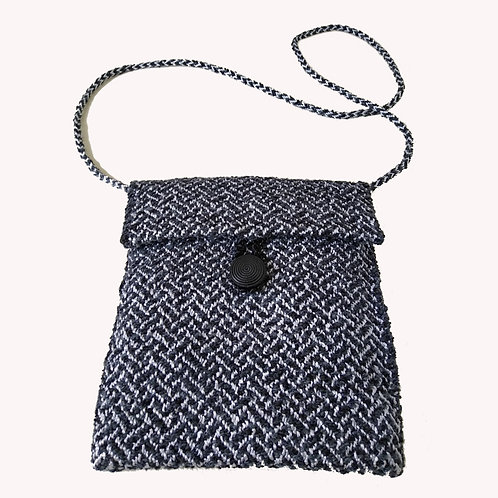 Handwoven plaited twill shoulder bag in black and white