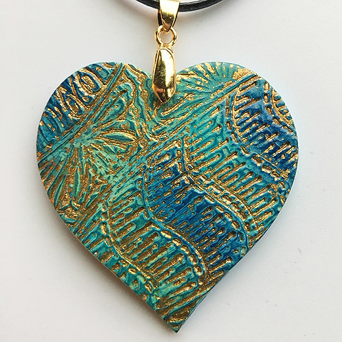 Blue-green pendant with gold embossing