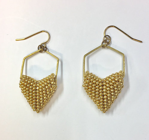 Gold beaded hearts in a brass honeycomb