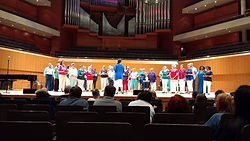 Manchester Piano Tutor Diane Paul is 5th from the left wth the Bridgewate Hall Choir, at the Hall.