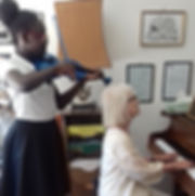 Grade 3 violin student Regina Ensah with Manchester Piano Tutor Diane Paul, accompanist