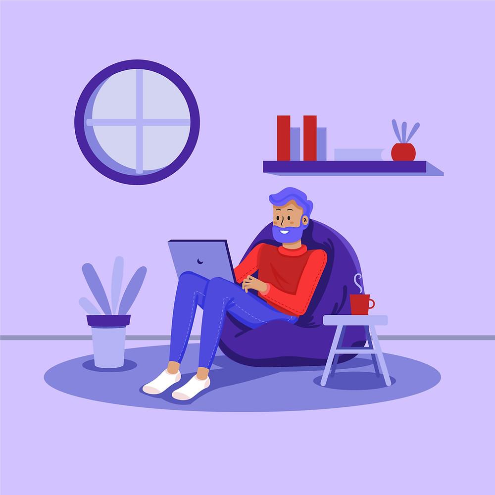 Un homme assis dans un fauteuil en mousse utilise son ordinateur.