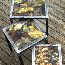 Handmade set table of raw iron with interchangeable table tops with signed and numbered art photography on glass (largest 40x40 cm)
