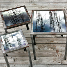 Handmade set table of raw iron with interchangeable table tops with signed and numbered art photography on glass (largest 40x40 cm).