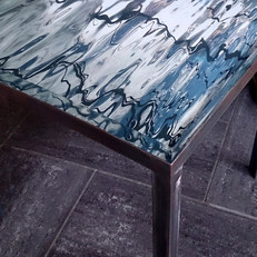 Hand forged table in raw iron with interchangeable signed and numbered art photo table top in 30 mm thick acrylic (46x46 cm).
