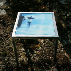 Hand forged table made from raw iron with interchangeable table top with signed and numbered art photo on 4mm tempered glass (40x40 cm)