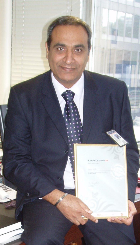 Gurpal Virdi receiving award