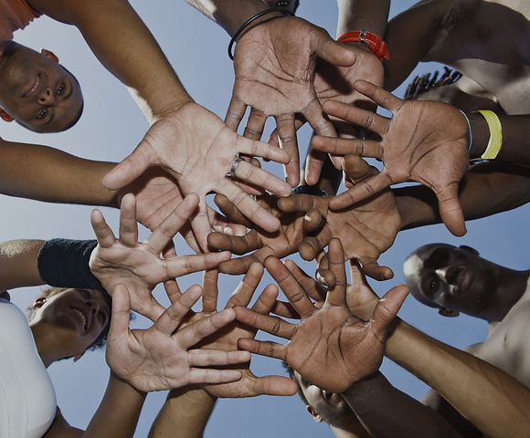 A group of mixed race people putting hands together_edited.jpg