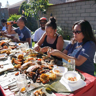 Kim eating at family Boodle Fight.jpg
