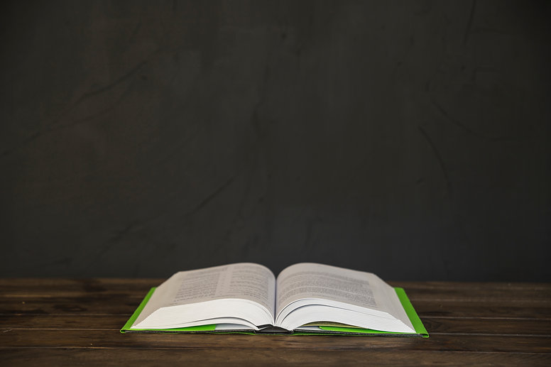 opened-book-on-wooden-table.jpg