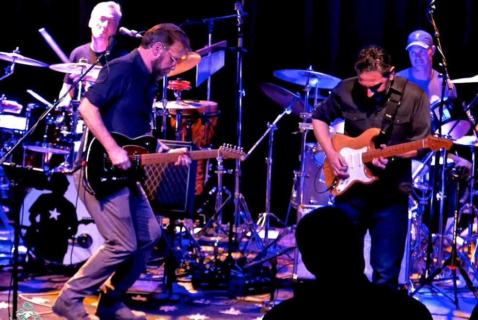 Guitarists and drummers at Fairfield Theater Company