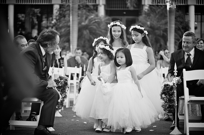 Flower girls walking the aisle at this wedding at the Longboat Key Club.
