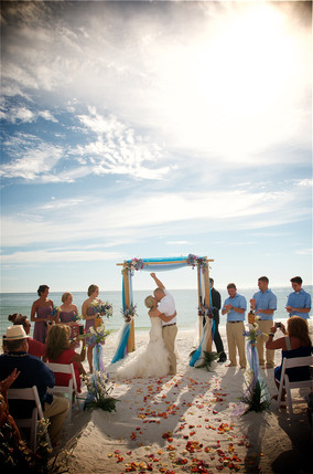 Bride and groom first kiss at a florida beach wedding