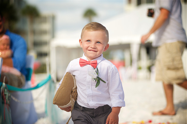 Ring bearer on at this Lido Beach wedding. It was a good thing the ring was tied on!