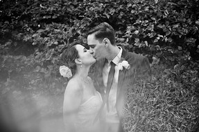 Kissing with flare at this St. Peteersburg, Florida wedding