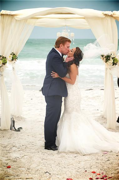 Bride and groom kiss at their Siesta Key beach wedding.