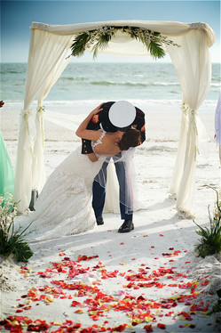 Bride and groom first kiss at a Lido Beach wedding.