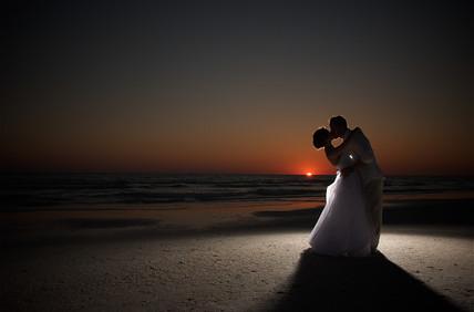 Sunset beach weddings always end with a kiss!