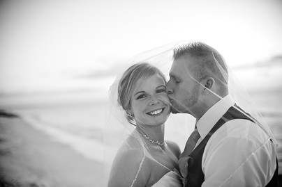 Bride and groom beach portrait