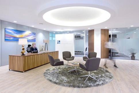 Black Walnut Crown-Cut Veneered reception desk with aluminium sled base