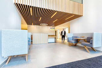Corian reception desk with solid timber slats interior