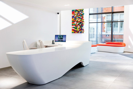 thermoformed corian reception desk with conical end profiles